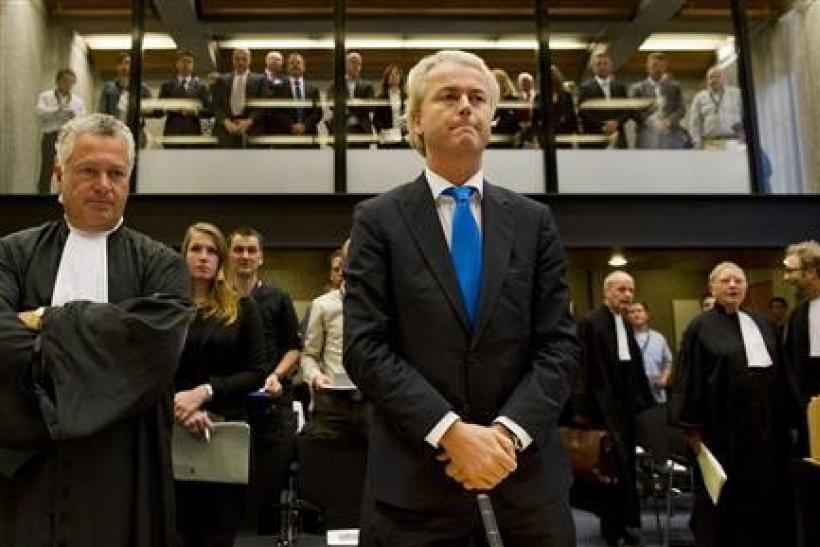 Right-wing Dutch MP Geert Wilders (C) appears in court with his lawyer Mr. Bram Moszkowicz (L) in Amsterdam