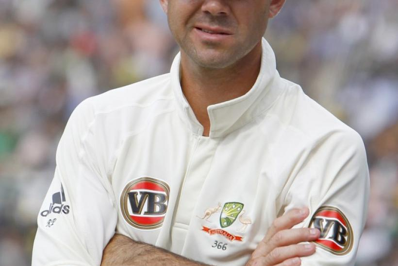 Australia's captain Ricky Ponting looks on during the trophy presentation ceremony after they lost to India during the fifth day of their second test cricket match in Bangalore October 13, 2010.