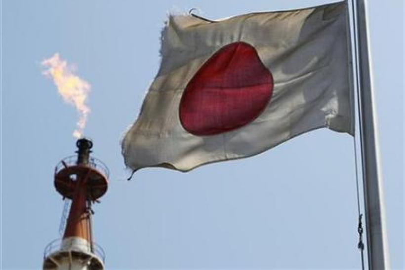A Japanese national flag flutters near a gas flare from a factory at Keihin industrial zone in Kawasaki in this file photo.