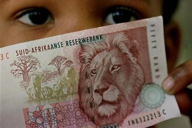 A South African child holds a 50 rand note in a file photo