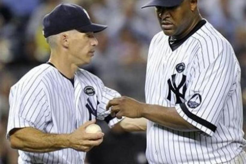New York Yankees manager Joe Girardi and starting pitcher CC Sabathia