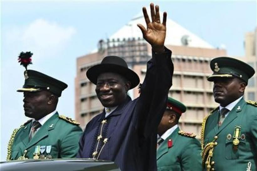 Nigeria's President Goodluck Jonathan waves during a military parade marking Nigeria's 50th independence anniversary in Abuja