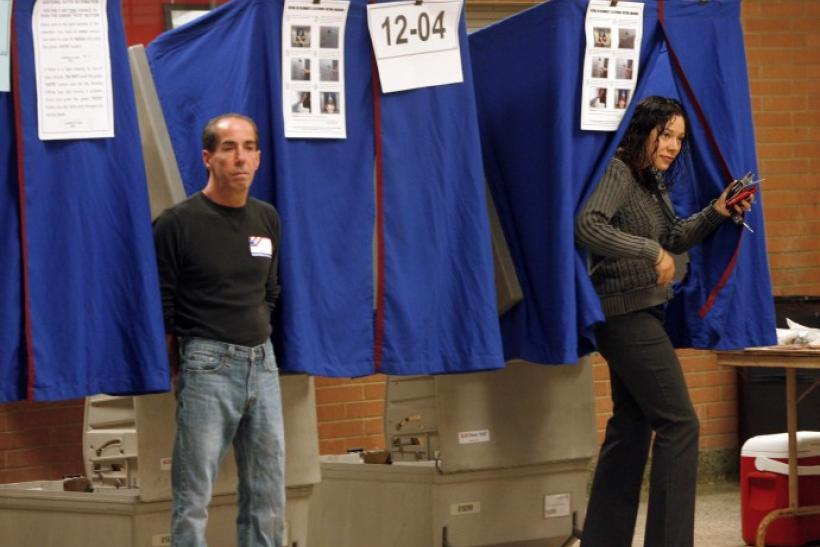 A voter exits a voting booth after casting her ballot in Wilmington