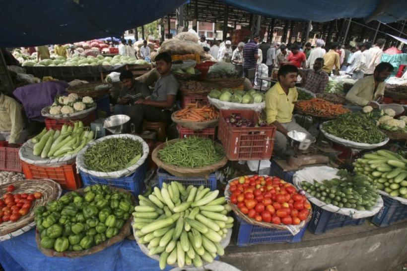 Vendors wait for customers at a wholesale vegetable market in the northern Indian city of Chandigarh May 28, 2010.