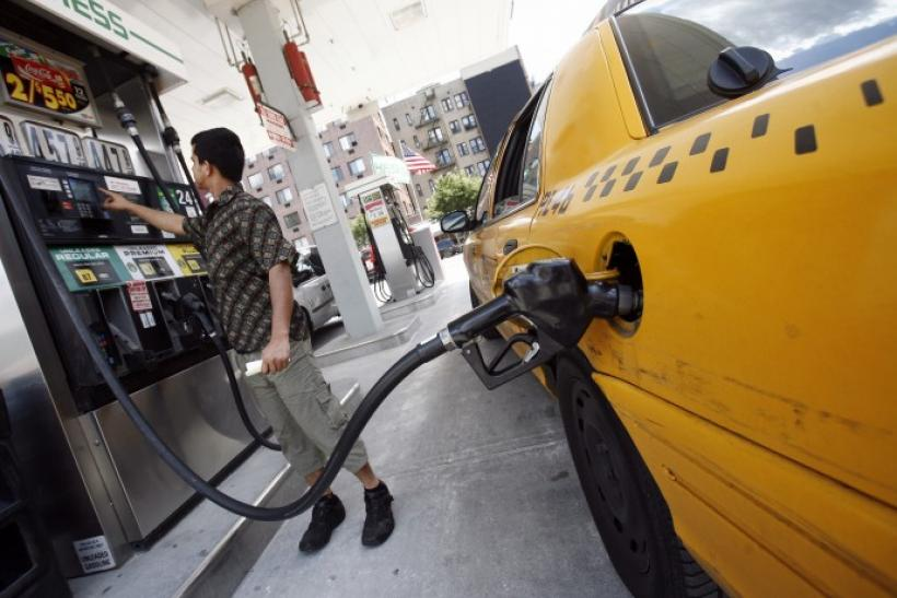 New York City cab driver fills his taxi up with gas at Hess station in New York