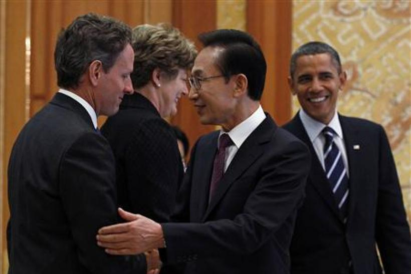 President Barack Obama and South Korea's President Lee Myung-bak greet U.S. Treasury Secretary Timothy Geithner and U.S. Ambassador to Korea Kathleen Stephens in Seoul
