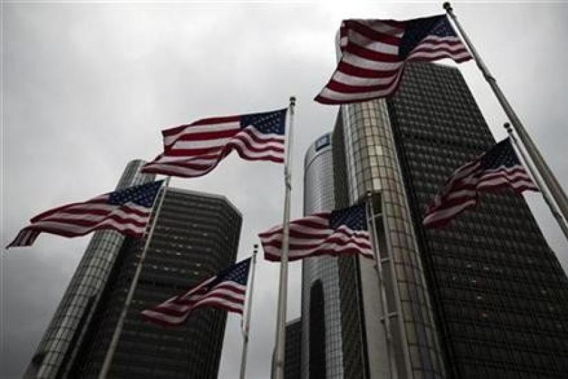 Flags wave in front of the General Motors Corp world headquarters in downtown in Detroit, May 28, 2009.