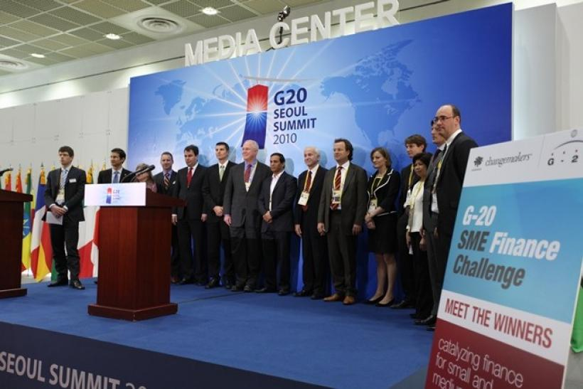 Winners of the SME finance challenge line up at the G20 Seoul Summit media center at the COEX convention center on November 12, 2010.