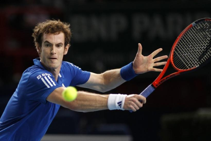 Andy Murray of Britain returns the ball to Croatia's Marin Cilic during their Paris Masters tennis tournament match.