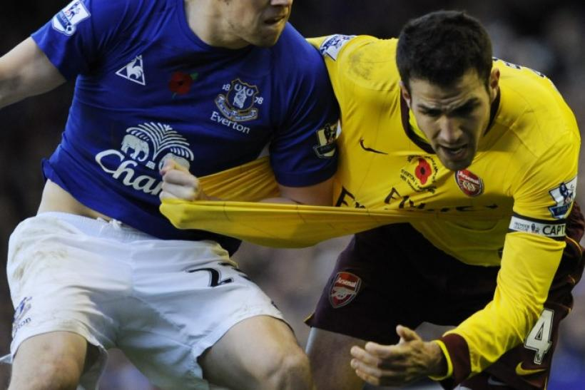 Everton's Coleman challenges Arsenal's Fabregas during their English Premier League soccer match in Liverpool.