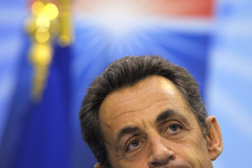 Sarkozy addresses reporters at the G20 and G8 summit