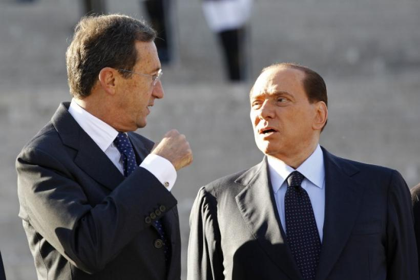 Berlusconi govt. wobbles as Fini loyalists quit