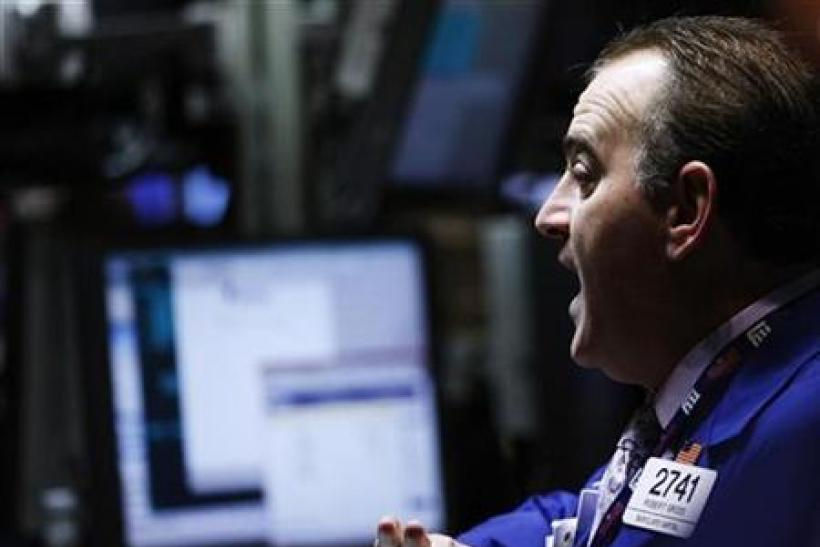 Robert Gross, a trader from Barclays Capital, works on the floor of the New York Stock Exchange in New York