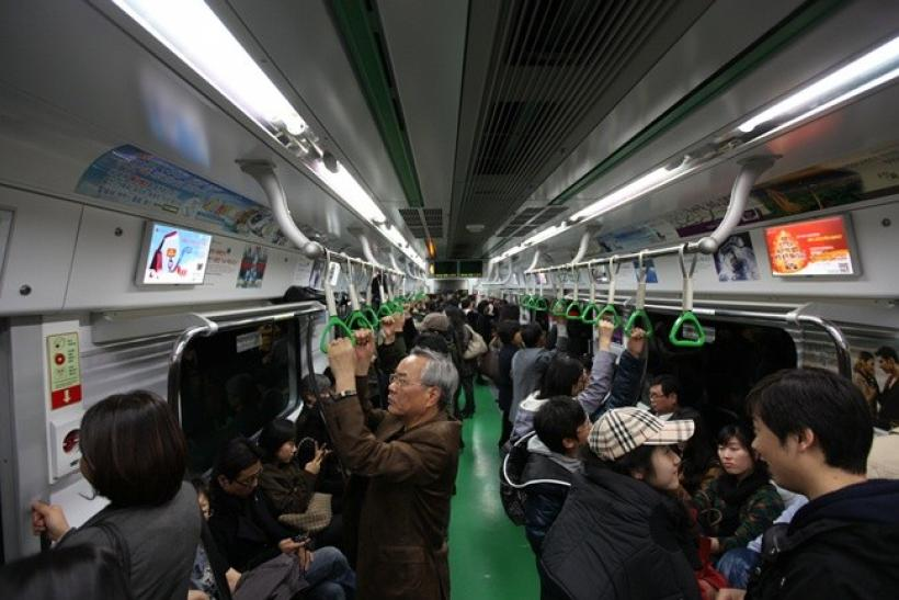 People ride on a subway train in Seoul November 13, 2010.