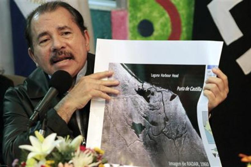 Nicaragua's President Daniel Ortega shows a map referring to the territorial dispute with Costa Rica during an address to the nation in Managua