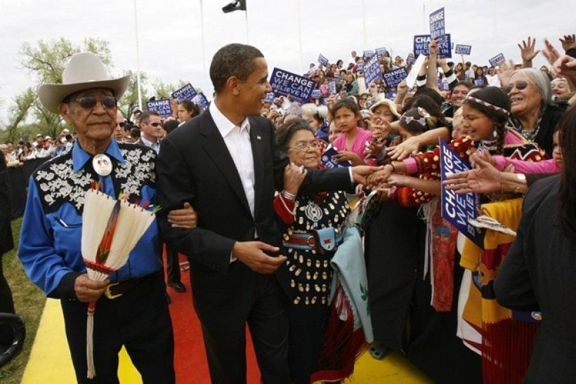 """Then US Democratic presidential candidate and US Senator Barack Obama, (D-IL), arrives with Hartford and Mary Blackeagle, his new Crow """"parents"""" who adopted him as a member of the Crow nation, for a campaign rally in Crow Agency, Montana May 19,"""