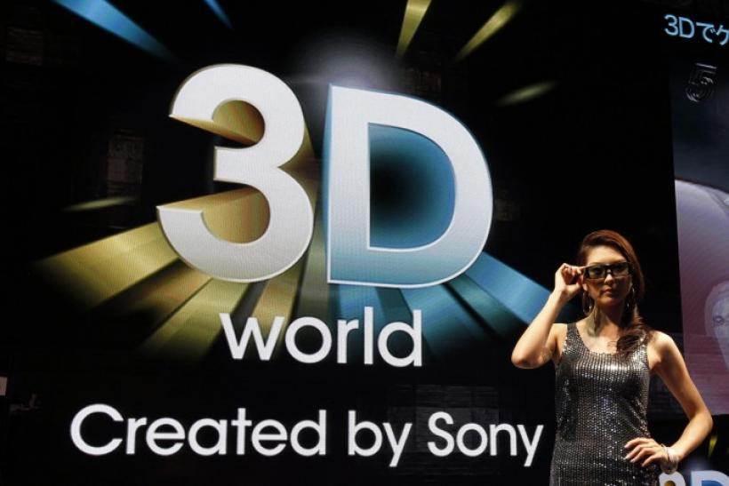 A model poses at Sony's booth to promote its 3D TV sets in Chiba, east of Tokyo,
