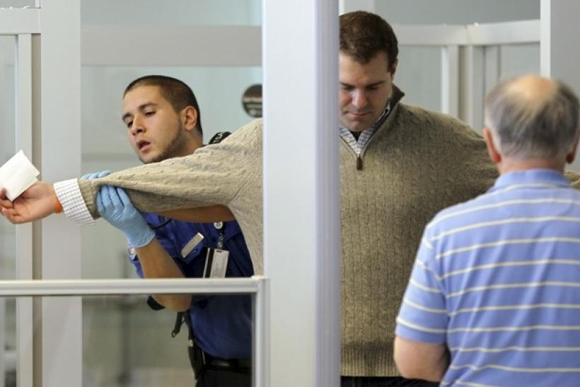 a us transportation security administration tsa officer carries out a physical search on a