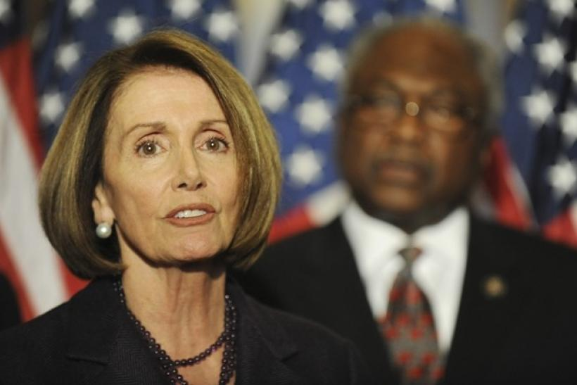 US House Speaker Nancy Pelosi (D-CA) (L) is flanked by Rep. James Clyburn (D-SC) (R).