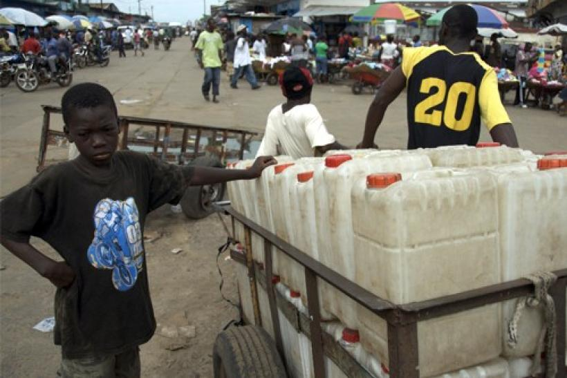 A boy sells jerrycans at a market area in the Liberian capital of Monrovia