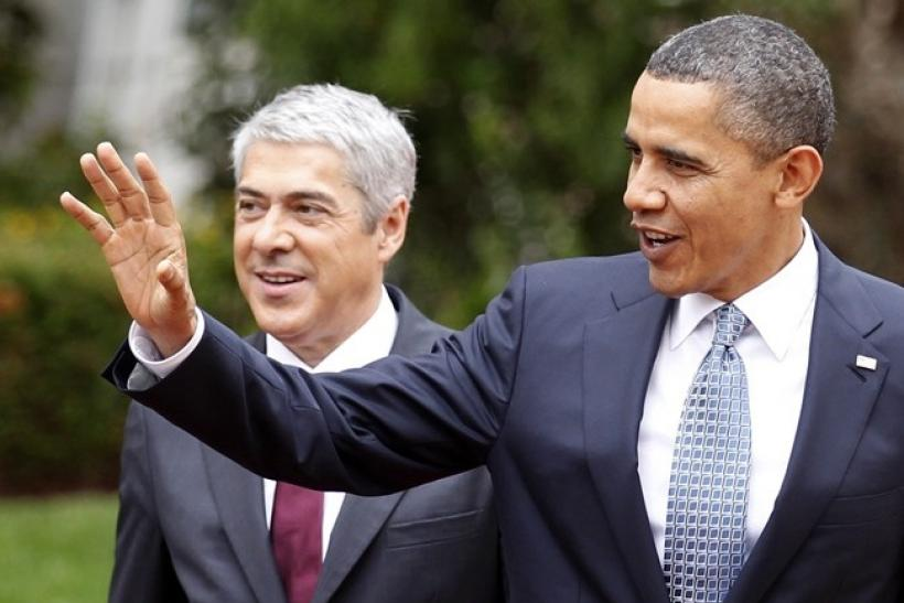 U.S. President Barack Obama waves after a meeting with Portugal's Prime Minister Jose Socrates (L) at the NATO Summit in Lisbon November 19, 2010.