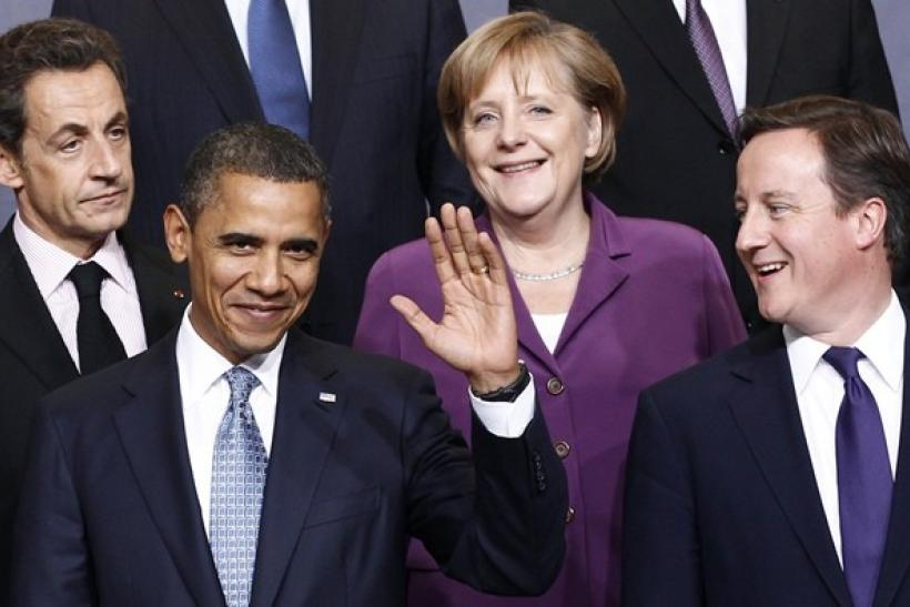 (L to R) France's President Nicolas Sarkozy, U.S. President Barack Obama, German Chancellor Angela Merkel and Britain's Prime Minister David Cameron pose for a family photo at the NATO summit in Lisbon November 19, 2010.