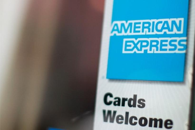 An American Express sign is seen on a restaurant door in New York