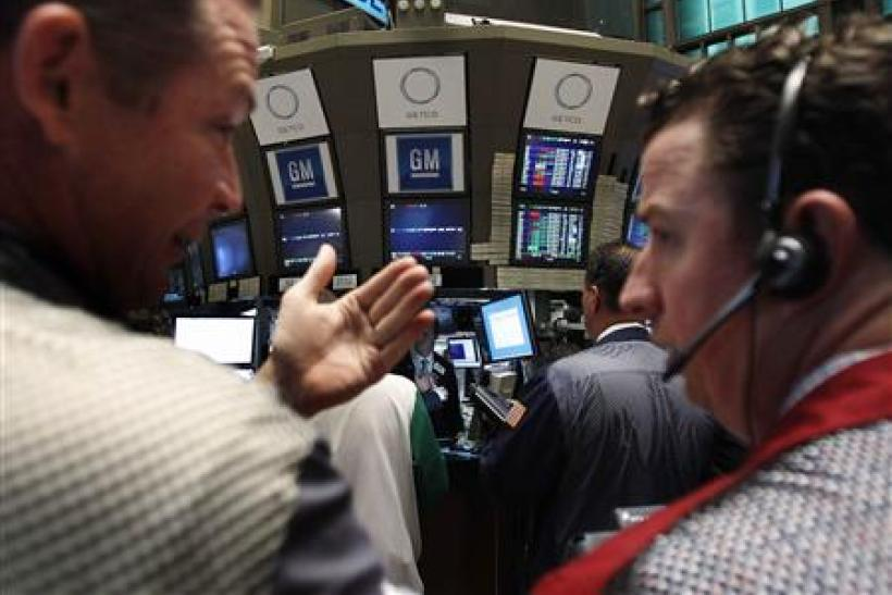 Traders gather around the General Motors trading post on the floor of the New York Stock Exchange