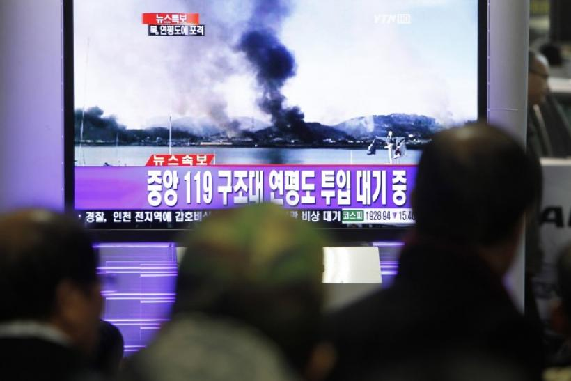 South Koreans watch news on television