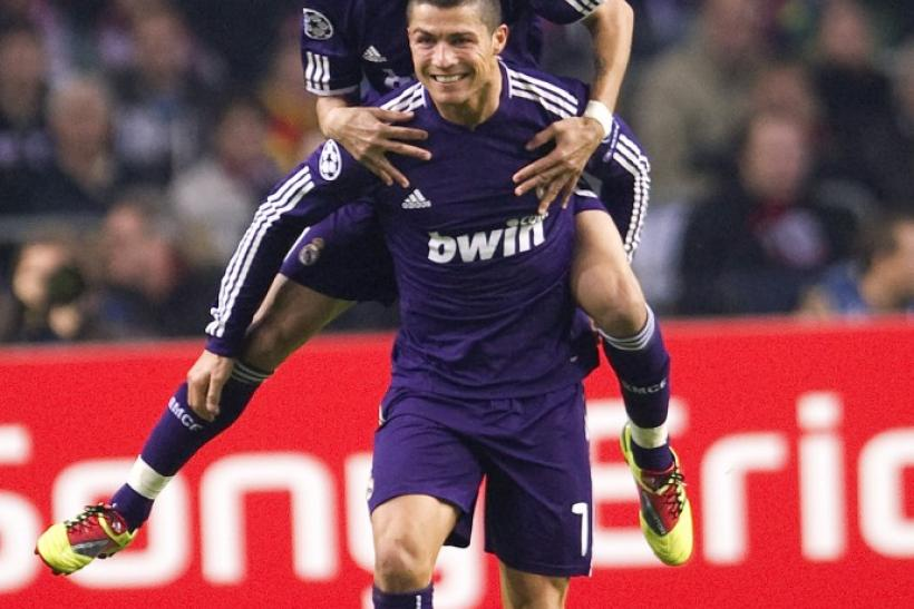 Real Madrid's Ronaldo and di Maria celebrate a goal against Ajax Amsterdam during their Champions League Group G soccer match in Amsterdam.