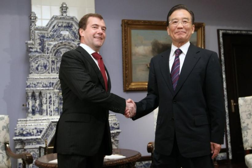 Russia's President Medvedev shakes hands with China's Premier Wen Jiabao during their meeting at the presidential residence in Gorki outside Moscow