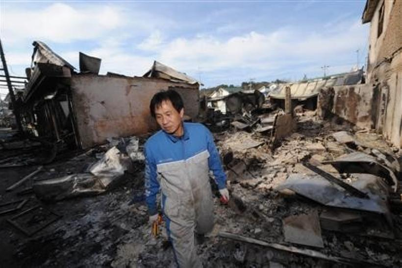 A local resident looks around damaged houses on Yeonpyeong Island