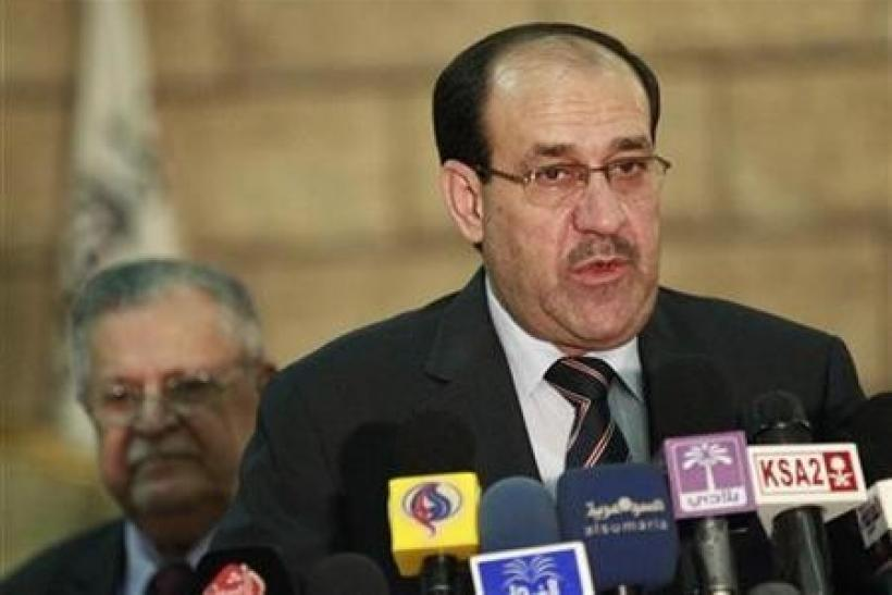 Iraq's Prime Minister Nuri al-Maliki speaks during a news conference in Baghdad