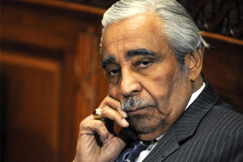 U.S. Representative Charles Rangel (D-NY) talks on his mobile phone as he waits for the panel to return from a break in his ethics hearing before the House Adjudicatory subcommittee at Capitol Hill in Washington, November 18, 2010