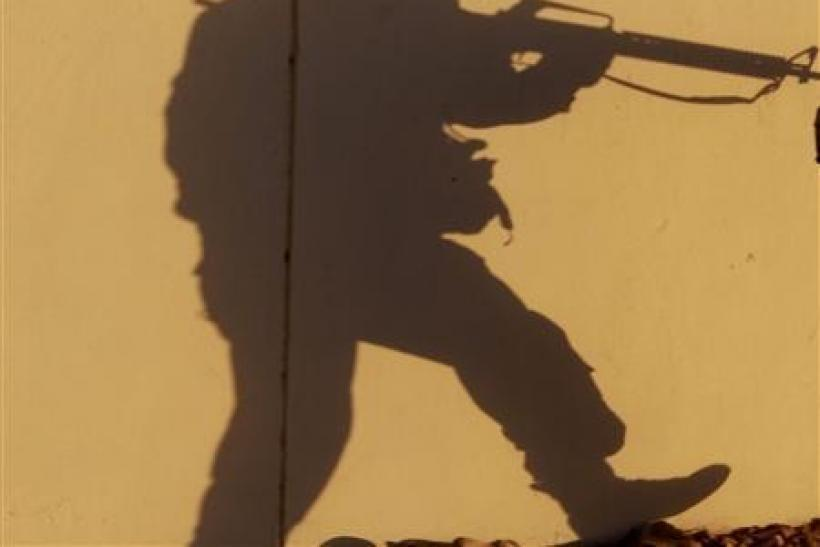 The shadow of a U.S. soldier from 2nd Brigade Special Troops Battalion