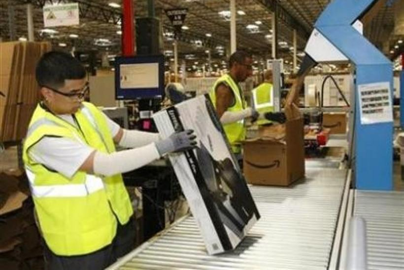 Employees at Amazon get merchandise ready to ship at the Phoenix Fulfillment Center in Goodyear, Arizona in this Nov. 2009 file photo