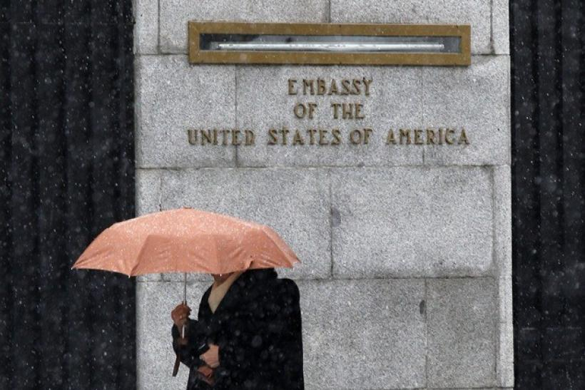 A woman walks past the U.S. embassy in Madrid November 29, 2010.