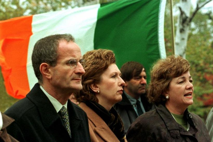 Ireland President Mary McAleese (C) and her husband Dr. Martin McAleese join Canadian Heritage Minister Sheila Copps (R) during a memorial ceremony in Grosse Ile near Quebec City October 11. McAleese paid tribute to the thousands of Irish immigrants who d