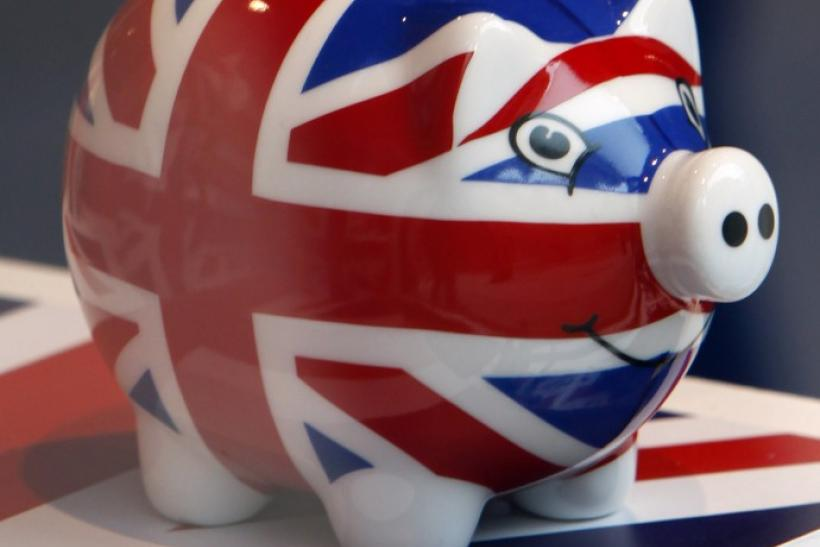 A piggy bank adorned with the colours of Britain's Union Jack flag is displayed in a souvenir shop in London