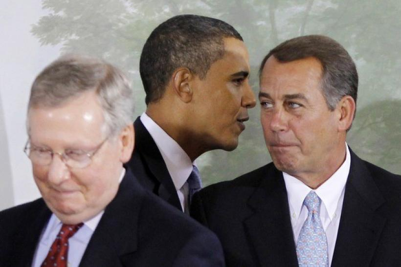 U.S. President Barack Obama between Senate Mitch McConnell, R-KY and Congressman John Boehner, R-OH
