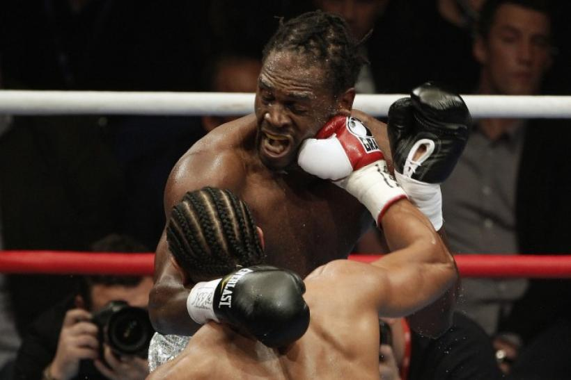 British boxer Haye lands a punch on compatriot Harrison their WBA world heavyweight title fight in Manchester.
