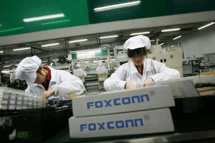 Employees work inside a Foxconn factory in the township of Longhua in the southern Guangdong province in this May 26, 2010 file photo.