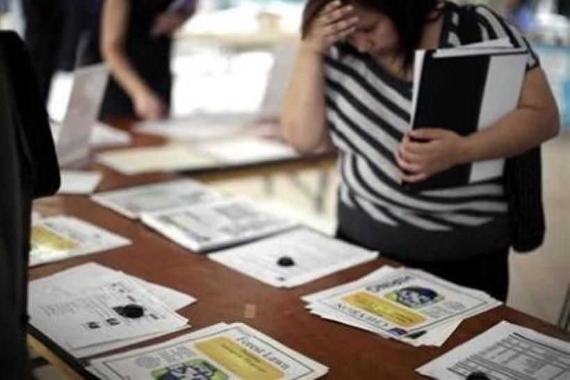 A woman browses job openings at a job fair in Los Angeles, California, October 12, 2010.