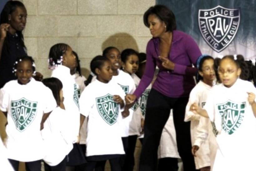 U.S. First Lady Michelle Obama dances with children at the New York Police