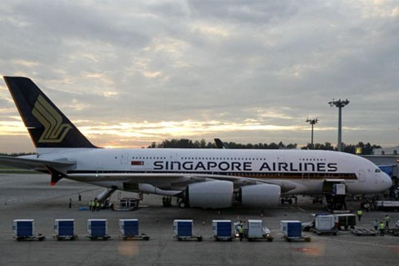 Cargo is prepared to be loaded onto the Airbus A380 superjumbo as it sits on the tarmac at Singapore's Changi Airport