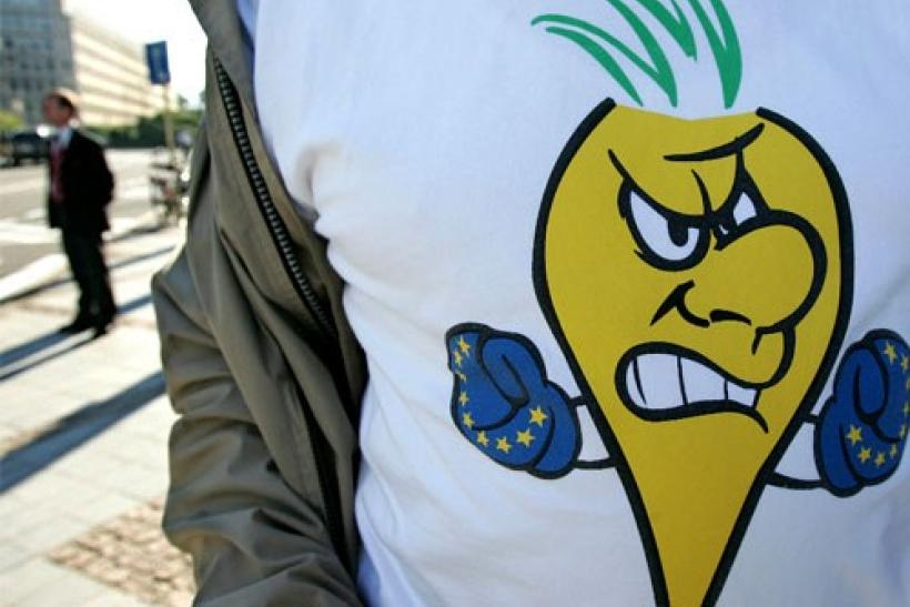 "A sugar producer displays ""Angry sugar beet"" on his t-shirt during a demonstration outside a meeting of EU agriculture ministers in Brussels, September 19, 2005"