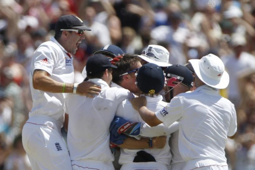 England's players celebrate winning after dismissing the final wicket of Australia's Siddle during the final day of the second Ashes cricket test in Adelaide.