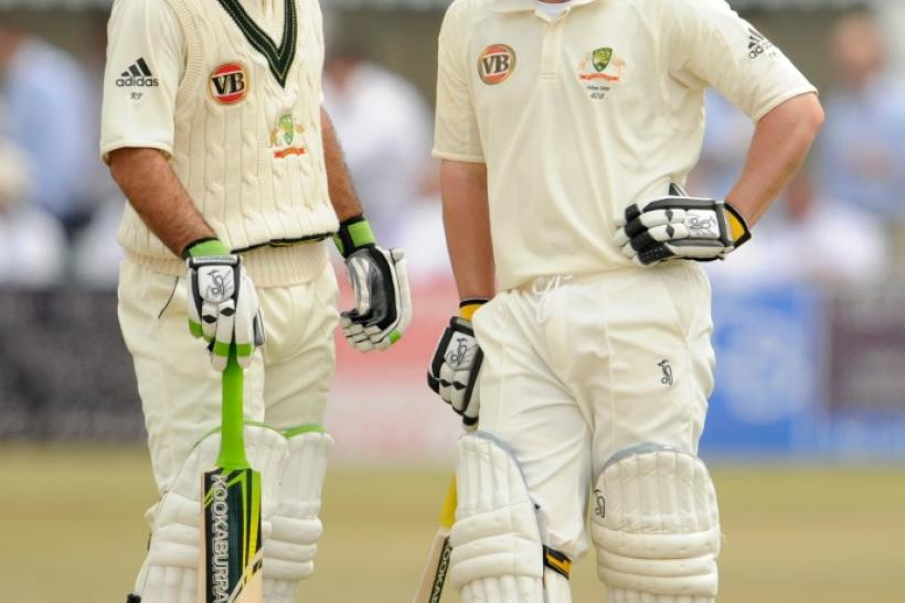 Australia's Ponting and Hughes chat during the third day's play of their cricket match against Sussex at the County Ground in Hove, East Sussex on 26/06/2009.