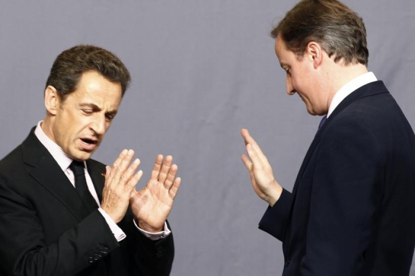 France's President Nicolas Sarkozy speaks with Britain's Prime Minister David Cameron at the NATO summit in Lisbon