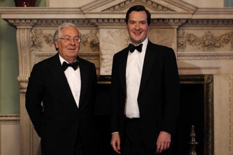 Bank of England Governor King poses with Britain's Chancellor of the Exchequer Osborne at the Lord Mayor's Dinner to the Bankers and Merchants of the City of London